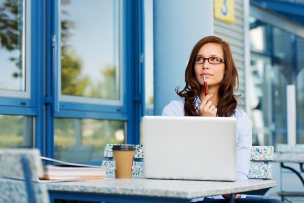 Woman choosing her blog site